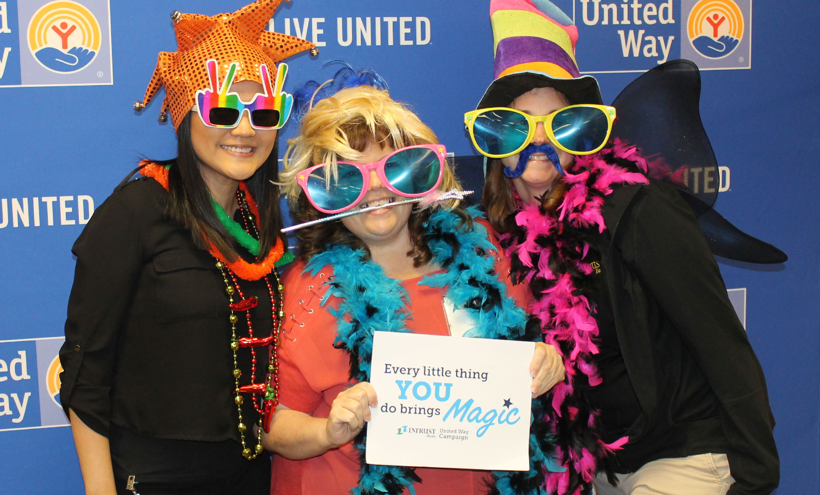 Employees taking part in the photo booth at our Agency Fair