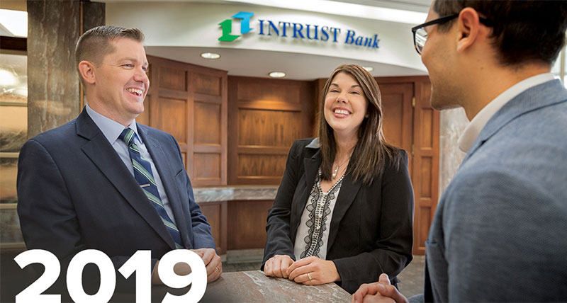 Image of INTRUST Employees laughing inside bank center
